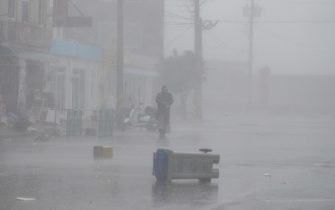 epa08651847 A fishman walks through heavy rain during weather caused by typhoon Haishen, near Imwon harbor in Donnghae, Gangwon-do province, South Korea 07 September 2020. According to the Korea Meteorological Administration (KMA) on 07 September, Typhoon Haishen is heading northward to the South Korean port city of Busan, bringing heavy rains and strong winds to the nation.  EPA/JEON HEON-KYUN