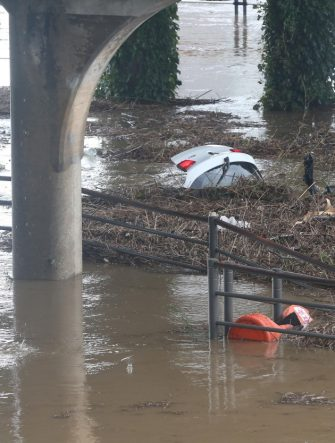 epa08651888 The boot of a vehicle is seen in a flooded parking lot, amid heavy rainfall caused by Typhoon Haishen, in Ulsan, South Korea, 07 September 2020.  EPA/YONHAP SOUTH KOREA OUT