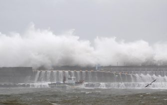 epa08651905 Large waves break over a coastal wall at Imwon harbor in Donnghae, Gangwon-do province, South Korea 07 September 2020. According to the Korea Meteorological Administration (KMA) on 07 September, Typhoon Haishen is heading northward to the South Korean port city of Busan, bringing heavy rains and strong winds to the nation.  EPA/JEON HEON-KYUN