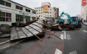 TOPSHOT - A clean-up crew works to remove roofs which were blown off into a street by strong winds brought by Typhoon Haishen in Fukuoka as the storm passes the southern Japanese island of Kyushu on September 7, 2020. - Powerful Typhoon Haishen approached South Korea on September 7 after slamming southern Japan with record winds and heavy rains that prompted evacuation warnings for millions. (Photo by STR / JIJI PRESS / AFP) / Japan OUT (Photo by STR/JIJI PRESS/AFP via Getty Images)