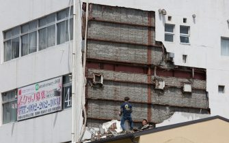 FUKUOKA, JAPAN - SEPTEMBER 07: People work to clean a collapsed wall of a building on September 07, 2020 in Fukuoka, Japan. Typhoon Haishen affected a large part of Kyushu island and around 8.3 million people are subject to evacuation orders. (Photo by Yuichi Yamazaki/Getty Images)