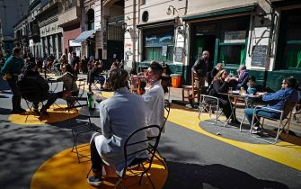 Customers sit at tables placed outside a bar at San Telmo neighborhood, in Buenos Aires, on Septiembre 5, 2020, amid the new coronavirus pandemic. - Restaurants and bars reopened in the city of Buenos Aires after six months of lockdown with tables placed in open-air spaces. (Photo by ALEJANDRO PAGNI / AFP) (Photo by ALEJANDRO PAGNI/AFP via Getty Images)
