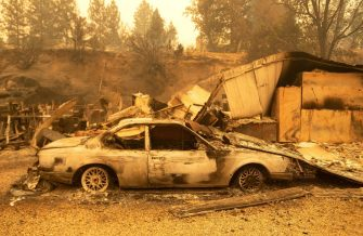 Burned vehicles smolder at a residence during the Creek fire in an unincorporated area of Fresno County, California on September 08, 2020. - Wildfires in California have torched a record more than two million acres, the state fire department said on September 7, as smoke hampered efforts to airlift dozens of people trapped by an uncontrolled blaze. (Photo by JOSH EDELSON / AFP) (Photo by JOSH EDELSON/AFP via Getty Images)