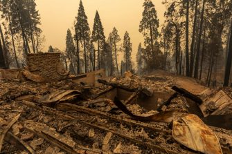 SHAVER LAKE, CA - SEPTEMBER 8: A community of forest homes lies in ruins along Auberry Road in the Meadow Lakes area after the Creek Fire swept through on September 8, 2020 near Shaver Lake, California. California Gov. Gavin Newsom has declared a state of emergency in five California counties after record heatwave temperatures fueled numerous wildfires over the Labor Day weekend. The state of emergency applies to Fresno, Madera and Mariposa, San Bernardino and San Diego counties.  (Photo by David McNew/Getty Images)