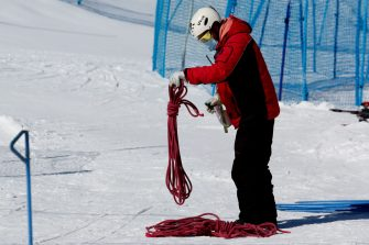 LO BARNECHEA, CHILE - AUGUST 14: A worker disinfects a rope at El Colorado Ski Resort as the facilities remain closed due to the Coronavirus pandemic on August 14, 2020 in Lo Barnechea, Chile. Despite being the best snow season in ten years, Ski resorts of the Lo Barnechea region, 60 km from Santiago, still could not open for tourists due to government-ordered restrictions to halt spread of COVID-19. While some centers still await for protocols to be approved and restrictions relaxed, some others decided to remain closed for the entire season, which represents major economic impact for all of them. (Photo by Marcelo Hernandez/Getty Images)
