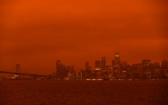 SAN FRANCISCO, CA - SEPTEMBER 09: Smoke from various wildfires burning across Northern California mixes with the marine layer, blanketing the San Francisco skyline in darkness and an orange glow, seen from Treasure Island on September 9, 2020 in San Francisco, California.  Over 2 million acres have burned this year as wildfires continue to burn across the state. (Photo by Philip Pacheco/Getty Images)