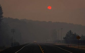 KALAMA, WA - SEPTEMBER 09: Tinted orange by wildfire smoke from Oregon and southern Washington, the sun sets behind a hill on September 9, 2020 in Kalama, Washington. Gov. Jay Inslee declared a statewide emergency as blazes continue to spread across the state. (Photo by David Ryder/Getty Images)