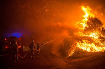 epa08667164 Firefighters try to extinguish one of the forest fires that originated in Cualedro, Ourense, northern Spain, 13 September 2020.  Over 2,250 hectares have been burnt with more than eleven forest fires in three different regions over the weekend.  EPA/Brais Lorenzo