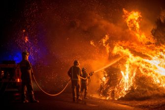 epa08667197 Firefighters try to extinguish one of the forest fires that originated in Cualedro, Ourense, northern Spain, 13 September 2020.  Over 2,250 hectares have been burnt with more than eleven forest fires in three different regions over the weekend.  EPA/Brais Lorenzo