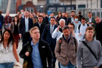 Commuters walk across London Bridge toward the City of London on September 7, 2020. - Prime Minister Boris Johnson and his Conservative government are using the end of the summer holidays and reopening of schools to encourage Britons to return to the office. (Photo by Adrian DENNIS / AFP) (Photo by ADRIAN DENNIS/AFP via Getty Images)