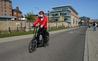 NEWCASTLE UPON TYNE, ENGLAND - SEPTEMBER 17: A cyclist wearing a face mask rides along Newcastle quayside on September 17, 2020 in Newcastle upon Tyne, England. Almost two million people in north-east England will be banned from mixing with other households and pubs will close early as coronavirus cases rise. Health Secretary Matt Hancock announced the temporary restrictions will be in place from midnight due to concerning rates of infection. The measures affect seven council areas, Newcastle, Northumberland, North Tyneside, South Tyneside, Gateshead, County Durham and Sunderland. (Photo by Ian Forsyth/Getty Images)