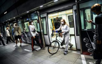 People wear mask at a metro station in Copenhagen shortly after midnight, on August 22, 2020, as the Danish government imposed to wear face mask or visor in public transport to prevent the spread of the new coronavirus. (Photo by Olafur STEINAR GESTSSON / Ritzau Scanpix / AFP) / Denmark OUT (Photo by OLAFUR STEINAR GESTSSON/Ritzau Scanpix/AFP via Getty Images)