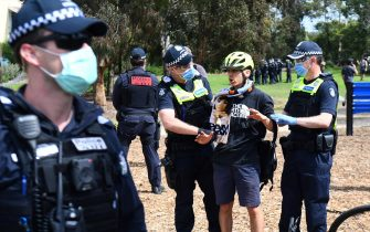 Police detain an anti-lockdown protester in the Melbourne suburb of Elsternwick on September 19, 2020. - Melbourne continues to enforce strict lockdown measures to battle a second wave of the coronavirus. (Photo by William WEST / AFP) (Photo by WILLIAM WEST/AFP via Getty Images)