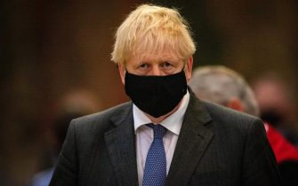Britain's Prime Minister Boris Johnson wearing a protective face covering, attends a service marking the 80th anniversary of the Battle of Britain at Westminster Abbey in central London on September 20, 2020. - Westminster Abbey has played a central role in remembering the sacrifice of those who fought in the battle, holding a Service of Thanksgiving and Rededication on Battle of Britain Sunday every year since 1944. (Photo by Aaron Chown / POOL / AFP) (Photo by AARON CHOWN/POOL/AFP via Getty Images)