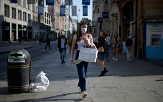 Shoppers wearing facemaks walk along Oxford street in central London on September 19, 2020. - Britain is seeing a second wave of the coronavirus outbreak, Prime Minister Boris Johnson said yesterday, as millions more people faced new restrictions and the government warned that another national lockdown could be imminent. (Photo by DANIEL LEAL-OLIVAS / AFP) (Photo by DANIEL LEAL-OLIVAS/AFP via Getty Images)