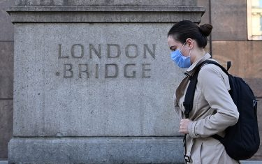 A commuter walks across London Bridge toward the City of London on September 15, 2020. - Britain's unemployment rate jumped above four percent in July on economic fallout from the coronavirus pandemic, official data showed today. (Photo by JUSTIN TALLIS / AFP) (Photo by JUSTIN TALLIS/AFP via Getty Images)