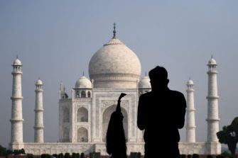 Tourists take pictures as the visit the Taj Mahal in Agra on September 21, 2020. - The Taj Mahal reopened to visitors on September 21 in a symbolic business-as-usual gesture even as India looks set to overtake the US as the global leader in coronavirus infections. (Photo by Sajjad  HUSSAIN / AFP) (Photo by SAJJAD  HUSSAIN/AFP via Getty Images)