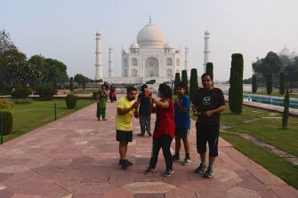 Tourists take pictures as they visit the Taj Mahal in Agra on September 21, 2020. - India's famed Taj Mahal and some schools reopened on September 21 as authorities pressed ahead with kickstarting the nations coronavirus-battered economy despite soaring infection numbers. (Photo by Sajjad HUSSAIN / AFP) (Photo by SAJJAD HUSSAIN/AFP via Getty Images)