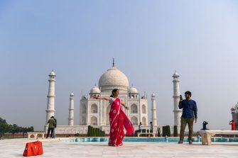 TOPSHOT - Tourists visit the Taj Mahal in Agra on September 21, 2020. - The Taj Mahal reopened to visitors on September 21 in a symbolic business-as-usual gesture even as India looks set to overtake the US as the global leader in coronavirus infections. (Photo by Sajjad HUSSAIN / AFP) (Photo by SAJJAD HUSSAIN/AFP via Getty Images)