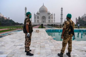 Security personnel stand guard at the Taj Mahal in Agra on September 21, 2020. - The Taj Mahal reopened to visitors on September 21 in a symbolic business-as-usual gesture even as India looks set to overtake the US as the global leader in coronavirus infections. (Photo by Sajjad HUSSAIN / AFP) (Photo by SAJJAD HUSSAIN/AFP via Getty Images)