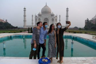 Tourists have their pictures taken at the Taj Mahal in Agra on September 21, 2020. - The Taj Mahal reopened to visitors on September 21 in a symbolic business-as-usual gesture even as India looks set to overtake the US as the global leader in coronavirus infections. (Photo by Sajjad HUSSAIN / AFP) (Photo by SAJJAD HUSSAIN/AFP via Getty Images)