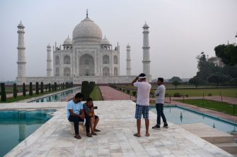 Tourists visit the Taj Mahal in Agra on September 21, 2020. - The Taj Mahal reopened to visitors on September 21 in a symbolic business-as-usual gesture even as India looks set to overtake the US as the global leader in coronavirus infections. (Photo by Sajjad HUSSAIN / AFP) (Photo by SAJJAD HUSSAIN/AFP via Getty Images)