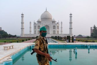 A security personnel patrols at the Taj Mahal in Agra on September 21, 2020. - The Taj Mahal reopened to visitors on September 21 in a symbolic business-as-usual gesture even as India looks set to overtake the US as the global leader in coronavirus infections. (Photo by Sajjad HUSSAIN / AFP) (Photo by SAJJAD HUSSAIN/AFP via Getty Images)