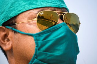 A soldier wearing a facemask as a preventive measure against the Covid-19 coronavirus stands guard at Taj Mahal in Agra on September 21, 2020. - The Taj Mahal reopened to visitors on September 21 in a symbolic business-as-usual gesture even as India looks set to overtake the US as the global leader in coronavirus infections. (Photo by Sajjad  HUSSAIN / AFP) (Photo by SAJJAD  HUSSAIN/AFP via Getty Images)