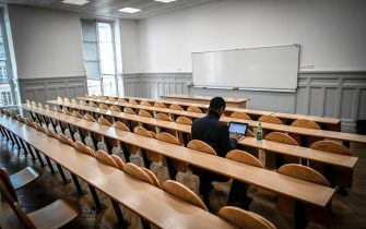 A  student sits in a classroom at Paris I Pantheon-Sorbonne University in Paris on March 30, 2018. (Photo by STEPHANE DE SAKUTIN / AFP)        (Photo credit should read STEPHANE DE SAKUTIN/AFP via Getty Images)