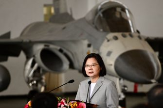 Taiwan's President Tsai Ing-wen (C) speaks in front of a domestically-produced F-CK-1 indigenous defence fighter jet (IDF) during her visit to Penghu Air Force Base on Magong island in the Penghu islands on September 22, 2020. (Photo by Sam Yeh / AFP) (Photo by SAM YEH/AFP via Getty Images)