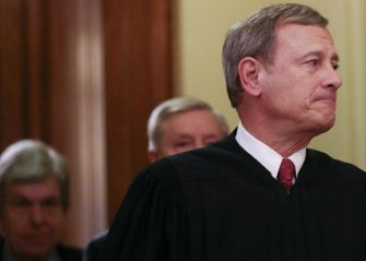 WASHINGTON, DC - FEBRUARY 05: Supreme Court Chief Justice John Roberts (R) departs the Senate chamber along with Sen. Lindsey Graham (R-SC) (C) and Sen. Roy Blunt (R-MO) after the Senate impeachment trial of U.S. President Donald Trump concluded on February 5, 2020 in Washington, DC. The Senate voted to acquit President Donald Trump in the impeachment trial. (Photo by Mario Tama/Getty Images)