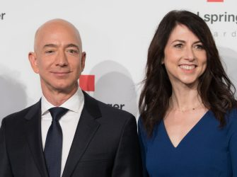 Amazon CEO Jeff Bezos and his wife MacKenzie Bezos  poses as they arrive at the headquarters of publisher Axel-Springer where he will receive the Axel Springer Award 2018 on April 24, 2018 in Berlin. (Photo by JORG CARSTENSEN / dpa / AFP) / Germany OUT (Photo by JORG CARSTENSEN/dpa/AFP via Getty Images)