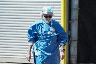"""Nurse Amy OSullivan, walks outside of Wyckoff Hospital in the Borough of Brooklyn on April 6, 2020 in New York. - New York Governor Andrew Cuomo on Monday extended a shutdown in the epicenter of America's deadly coronavirus pandemic until near the end of the month. Cuomo said the COVID-19 death rate in New York was """"effectively flat"""" for the past two days but announced that schools and non-essential businesses must stay shut until April 29. (Photo by Bryan R. Smith / AFP) (Photo by BRYAN R. SMITH/AFP via Getty Images)"""