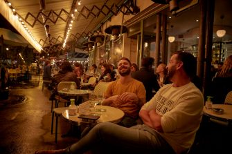 PARIS, FRANCE - SEPTEMBER 23: Parisians relax on the terrace of a Paris cafe as the French Government announced that from Monday all bars and cafes in Paris will be made to shut at 10pm as part of a string of new measures to curb the spread of Covid-19 in France on September 23, 2020 in Paris, France. With the rise in Coronavirus cases in France at 204 per 100,000 inhabitants, the French Government have followed other governments in introducing new restrictions aimed at reducing the spread of Covid-19 whilst avoiding another national lockdown. In large cities, including Paris, gatherings will be limited to ten people in public spaces, bars to close at 10 p.m., local and student parties will be prohibited. (Photo by Kiran Ridley/Getty Images)