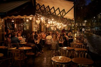 PARIS, FRANCE - SEPTEMBER 23: People relax on the terrace of a Paris cafe as the French Government announced that from Monday all bars and cafes in Paris will be made to shut at 10pm as part of a string of new measures to curb the spread of Covid-19 in France on September 23, 2020 in Paris, France. With the rise in Coronavirus cases in France at 204 per 100,000 inhabitants, the French Government have followed other governments in introducing new restrictions aimed at reducing the spread of Covid-19 whilst avoiding another national lockdown. In large cities, including Paris, gatherings will be limited to ten people in public spaces, bars to close at 10 p.m., local and student parties will be prohibited. (Photo by Kiran Ridley/Getty Images)