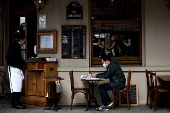 A man sits at the terrace of a restaurant in Paris, on June 15, 2020, one day after French president announced the reopening of dining rooms of Parisian cafes and restaurants, starting today. - While restaurants across most of France were allowed to open earlier this month, those in and around the capital, where COVID-19 circulation remained high, could serve clients only on outdoor terraces. (Photo by Philippe LOPEZ / AFP) (Photo by PHILIPPE LOPEZ/AFP via Getty Images)