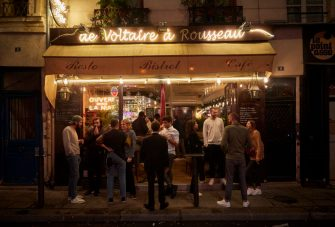 PARIS, FRANCE - SEPTEMBER 23: Parisians stand outside a busy bar as the French Government announced that from Monday all bars in Paris will be made to shut at 10pm as part of a string of new measures to curb the spread of Covid-19 in France on September 23, 2020 in Paris, France. With the rise in Coronavirus cases in France at 204 per 100,000 inhabitants, the French Government have followed other governments in introducing new restrictions aimed at reducing the spread of Covid-19 whilst avoiding another national lockdown. In large cities, including Paris, gatherings will be limited to ten people in public spaces, bars to close at 10 p.m., local and student parties will be prohibited. (Photo by Kiran Ridley/Getty Images)