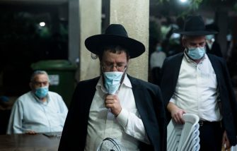 Bnei Brak, ISRAEL - SEPTEMBER 17:  Ultra Orthodox Jews keep social distancing as they pray in an outdoor synagogue amid a Coronavirus pandemic ahead of Rosh Hashanah, the Jewish new year, on September 17, 2020 in Bnei Brak, Israel. As the country grapples with a surge in Covid-19 cases it has imposed a three-week lockdown that coincides with Rosh Hashanah, the Jewish new year, and Yom Kippur, the Day of Atonement.  (Photo by Amir Levy/Getty Images)