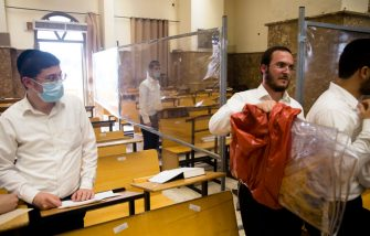 BNEI BRAK, ISRAEL - SEPTEMBER 18:  Ultra Orthodox Jewish men prepare for praying in a synagogue fitted with plastic sheets amid the Coronavirus pandemic ahead of Rosh Hashanah, the Jewish new year, on September 18, 2020 in Bnei Brak, Israel. As the country grapples with a surge in Covid-19 cases it has imposed a three-week lockdown that coincides with Rosh Hashanah, the Jewish new year, and Yom Kippur, the Day of Atonement.  (Photo by Amir Levy/Getty Images)