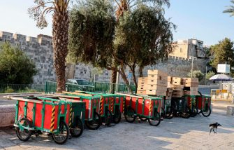 Street vending carts are chained up by Jerusalem's old city walls, on September 19, 2020, during a lockdown due to a spike in COVID-19 infection cases. - Israel imposed a second nationwide lockdown to tackle one of the world's highest coronavirus infection rates, despite public protests over the new blow to the economy. The three-week shutdown from yesterday just hours before Rosh Hashana, the Jewish New Year, and will extend through other key religious holidays, including Yom Kippur and Sukkot. (Photo by MENAHEM KAHANA / AFP) (Photo by MENAHEM KAHANA/AFP via Getty Images)