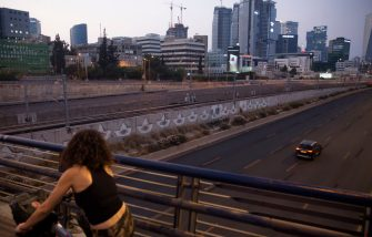 TEL AVIV, ISRAEL - SEPTEMBER 18: A woman looks at an empty main road as Israel enters a new lockdown on  September 18, 2020 in Tel Aviv, Israel. As the country grapples with a surge in Covid-19 cases it has imposed a three-week lockdown that coincides with Rosh Hashanah, the Jewish new year, and Yom Kippur, the Day of Atonement.  (Photo by Amir Levy/Getty Images)