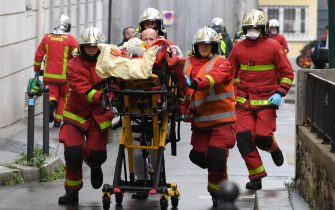French firefighters push a gurney carrying an injured person near the former offices of the French satirical magazine Charlie Hebdo following an alleged attack by a man wielding a machete in Paris on September 25, 2020. - The threats coincide with the trial of 14 suspected accomplices of the perpetrators of the massacres at Charlie Hebdo and a Jewish supermarket that left a total of 17 dead. (Photo by Alain JOCARD / AFP) (Photo by ALAIN JOCARD/AFP via Getty Images)