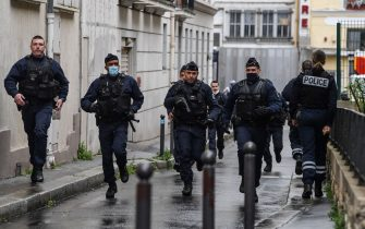 TOPSHOT - French police officers rush to the scene after people were injured near the former offices of the French satirical magazine Charlie Hebdo following an alleged attack by a man wielding a knife in the capital Paris on September 25, 2020. - Four people were injured, two seriously, in a knife attack in Paris on September 25, 2020, near the former offices of French satirical magazine Charlie Hebdo, a source close to the investigation told AFP. Two of the victims were in a critical condition, the Paris police department said, adding two suspects were on the run. The stabbing came as a trial was underway in the capital for alleged accomplices of the authors of the January 2015 attack on the Charlie Hebdo weekly that claimed 12 lives. (Photo by Alain JOCARD / AFP) (Photo by ALAIN JOCARD/AFP via Getty Images)
