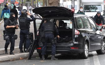 French police intervention unit (GSO) kit up near the former offices of the French satirical magazine Charlie Hebdo following an alleged attack by a man wielding a knife in Paris on September 25, 2020. - The threats has coincide with the trial of 14 suspected accomplices of the perpetrators of the massacres at Charlie Hebdo and a Jewish supermarket that left a total of 17 dead. (Photo by Alain JOCARD / AFP) (Photo by ALAIN JOCARD/AFP via Getty Images)