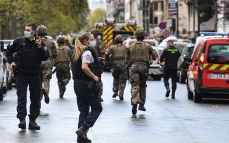 TOPSHOT - French army soldiers rush to the scene after several people were injured near the former offices of the French satirical magazine Charlie Hebdo following an alleged attack by a man wielding a knife in the capital Paris on September 25, 2020. - Four people were injured, two seriously, in a knife attack in Paris on September 25, 2020, near the former offices of French satirical magazine Charlie Hebdo, a source close to the investigation told AFP. Two of the victims were in a critical condition, the Paris police department said, adding two suspects were on the run. The stabbing came as a trial was underway in the capital for alleged accomplices of the authors of the January 2015 attack on the Charlie Hebdo weekly that claimed 12 lives. (Photo by Alain JOCARD / AFP) (Photo by ALAIN JOCARD/AFP via Getty Images)