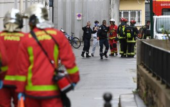 French firefighters move an injured person into a waiting ambulance near the former offices of the French satirical magazine Charlie Hebdo following an alleged attack by a man wielding a knife in Paris on September 25, 2020. - Four people were injured, two seriously, in a knife attack in Paris on September 25, 2020, near the former offices of French satirical magazine Charlie Hebdo, a source close to the investigation told AFP. Two of the victims were in a critical condition, the Paris police department said, adding two suspects were on the run. The stabbing came as a trial was underway in the capital for alleged accomplices of the authors of the January 2015 attack on the Charlie Hebdo weekly that claimed 12 lives. (Photo by Alain JOCARD / AFP) (Photo by ALAIN JOCARD/AFP via Getty Images)
