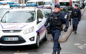 French police officers make their way to the scene, after several people were injured near the former offices of the French satirical magazine Charlie Hebdo following an attack by a man wielding a knife in the capital Paris on September 25, 2020. - Four people were injured, two seriously, in a knife attack in Paris on September 25, 2020, near the former offices of French satirical magazine Charlie Hebdo, a source close to the investigation told AFP. Two of the victims were in a critical condition, the Paris police department said, adding two suspects were on the run. The stabbing came as a trial was underway in the capital for alleged accomplices of the authors of the January 2015 attack on the Charlie Hebdo weekly that claimed 12 lives. (Photo by GEOFFROY VAN DER HASSELT / AFP) (Photo by GEOFFROY VAN DER HASSELT/AFP via Getty Images)
