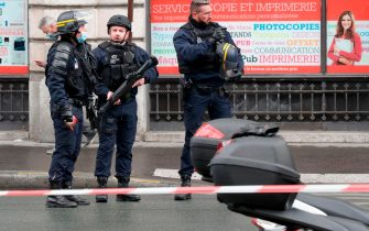 French police officers cordon off the scene, after several people were injured near the former offices of the French satirical magazine Charlie Hebdo following an attack by a man wielding a knife in the capital Paris on September 25, 2020. - Four people were injured, two seriously, in a knife attack in Paris on September 25, 2020, near the former offices of French satirical magazine Charlie Hebdo, a source close to the investigation told AFP. Two of the victims were in a critical condition, the Paris police department said, adding two suspects were on the run. The stabbing came as a trial was underway in the capital for alleged accomplices of the authors of the January 2015 attack on the Charlie Hebdo weekly that claimed 12 lives. (Photo by GEOFFROY VAN DER HASSELT / AFP) (Photo by GEOFFROY VAN DER HASSELT/AFP via Getty Images)