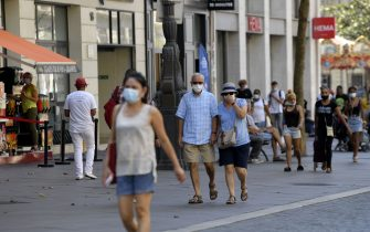 Pedestrians wearing   face masks  walk in Marseille, southeastern France, on September 14, 2020, amid the Covid-19 pandemic, caused by the novel coronavirus. (Photo by NICOLAS TUCAT / AFP) (Photo by NICOLAS TUCAT/AFP via Getty Images)