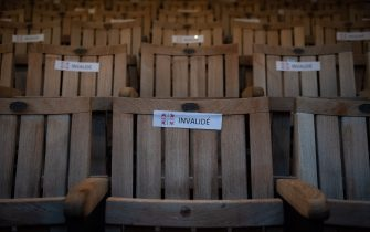A photo shows seats with stickers to respect social distancing due to the Covid-19 coronavius pandemic, in the Theatre de l'Archeveche in Aix-en-Provence, southern France on July 23, 2020. (Photo by CLEMENT MAHOUDEAU / AFP) (Photo by CLEMENT MAHOUDEAU/AFP via Getty Images)